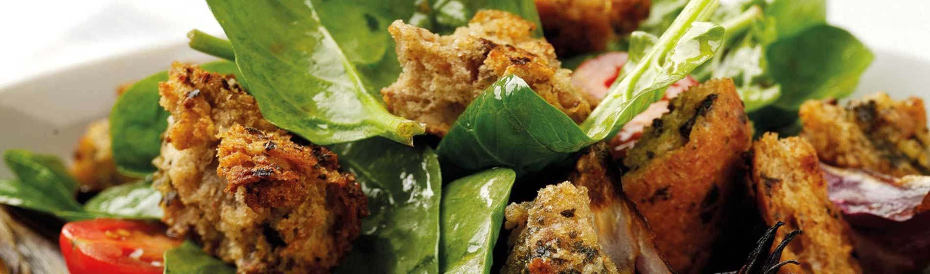 Winter Spinach Cherry Tomato and Red Onion Salad with Warm Pesto Wholegrain Croutons